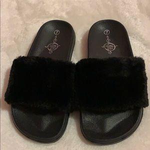 Black furry slippers